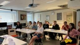 Students listening to a teacher