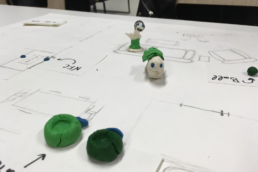 Students drawing with clay figures