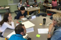 Students sitting around a desk